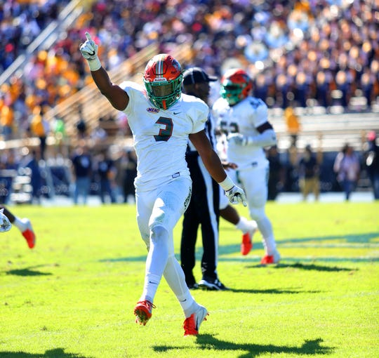 FAMU defensive end Antonio Miller celebrates the 22-21 win over N.C. A&T. The first-place Rattlers have a 4-0 record in the MEAC.
