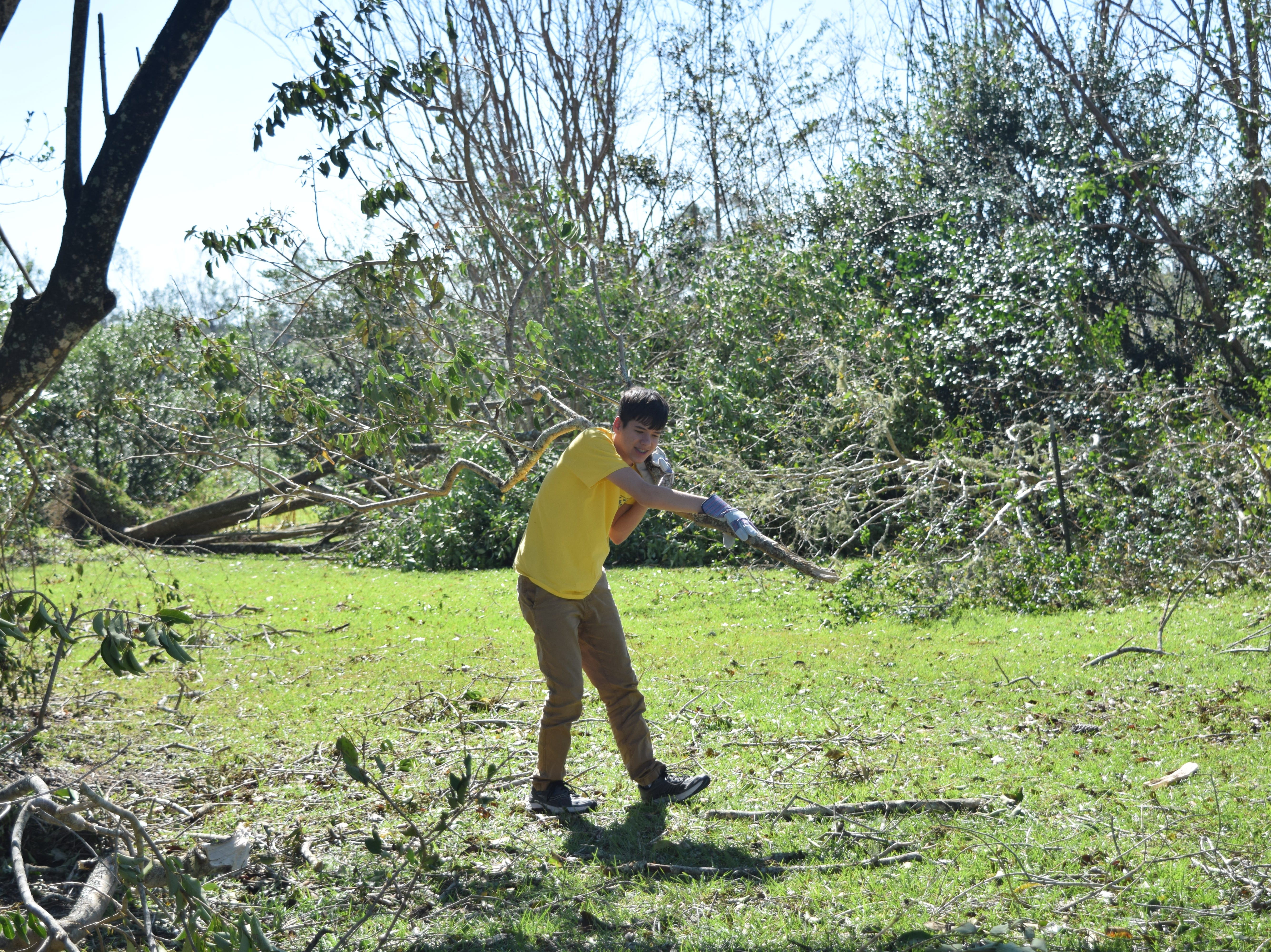 A volunteer with Mormon Helping Hands, cleans up a house in Quincy after Hurricane Michael.