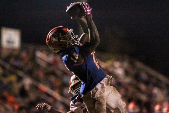Taylor County's Robert Glanton goes up high to haul in a 15-yard touchdown catch during a 35-6 win over Williston.