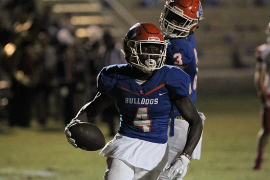 Taylor County's Devante Glover celebrates a touchdown catch in a 35-6 win over Williston.