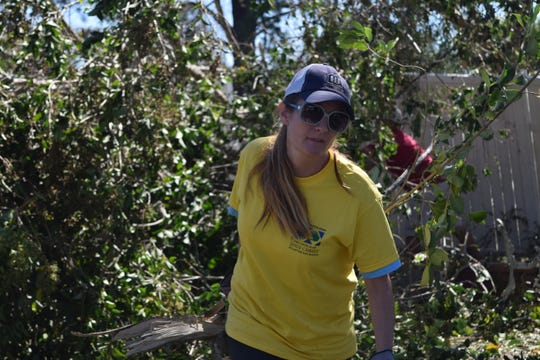 Sariah Homan, a volunteer with Mormon Helping Hands, cleans up a house in Quincy after Hurricane Michael.
