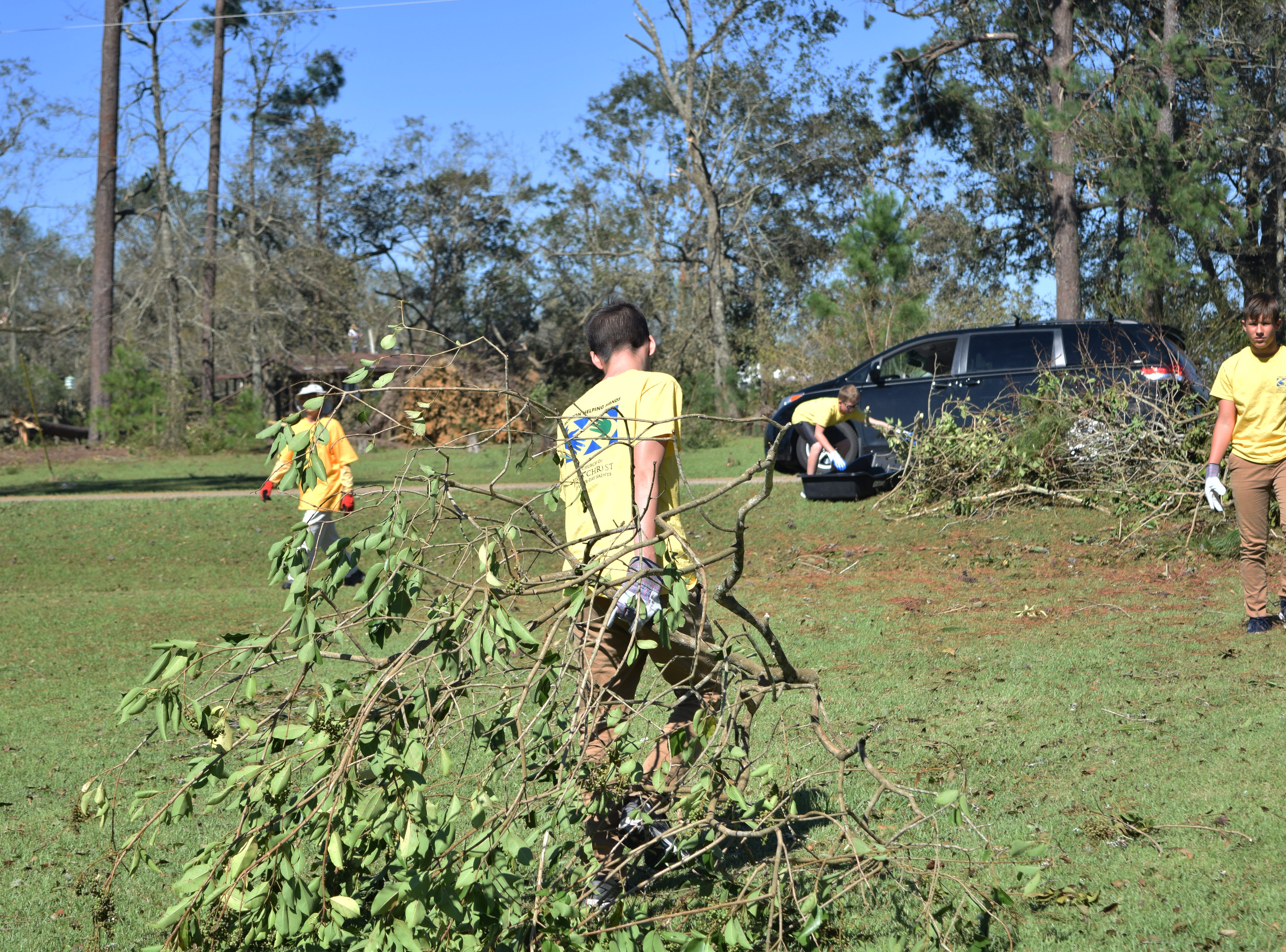 Volunteers with Mormon Helping Hands clean up a house in Quincy after Hurricane Michael.