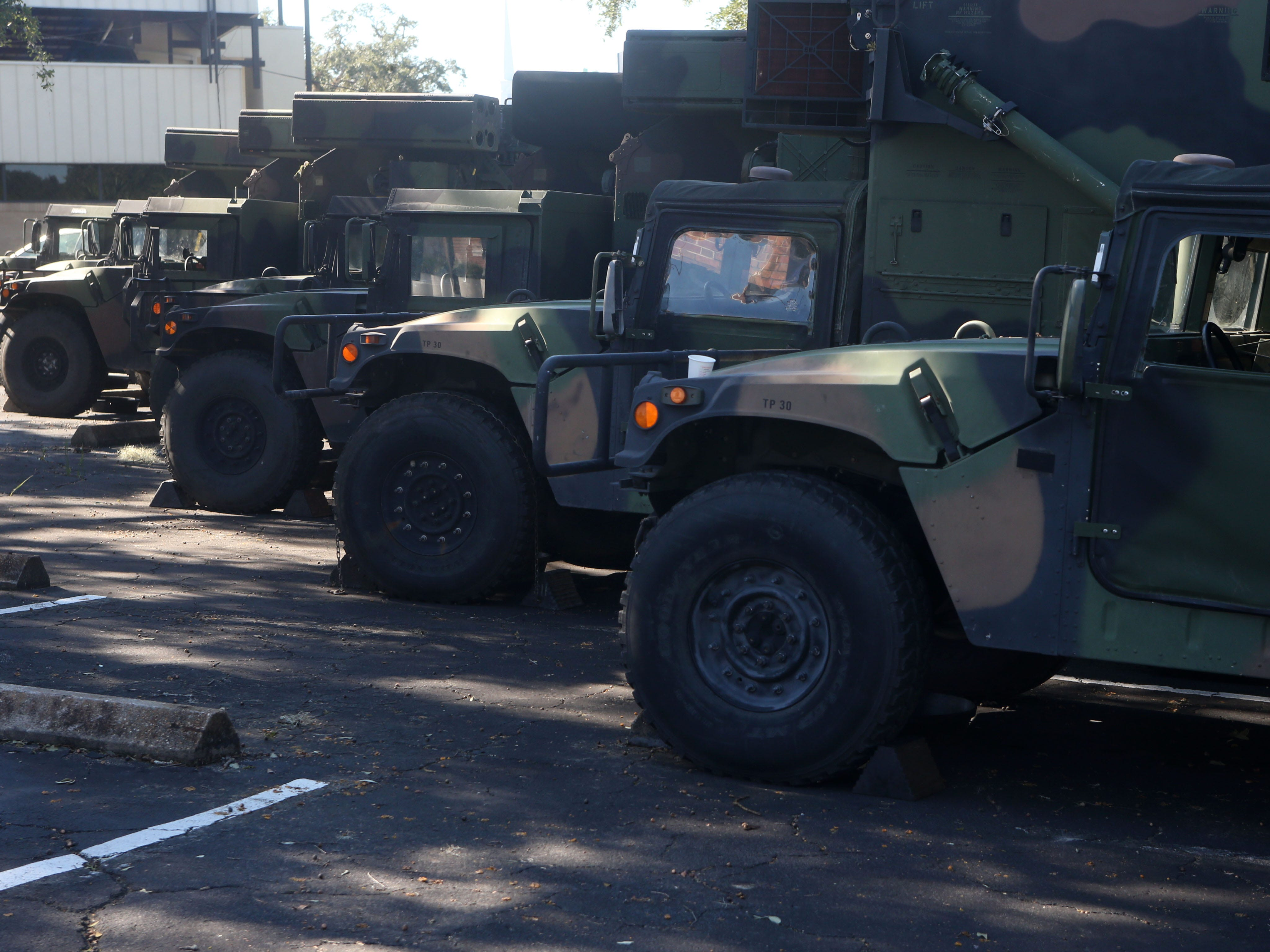The National Guard, stationed throughout Tallahassee hands out ice, water, and meals ready to eat on Oct. 13, 2018, three days after Hurricane Michael struck the Florida panhandle.