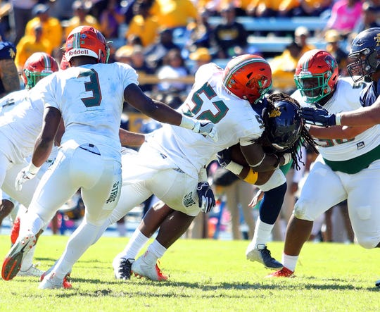FAMU linebacker Derrick Mayweather dives in for a tackle.