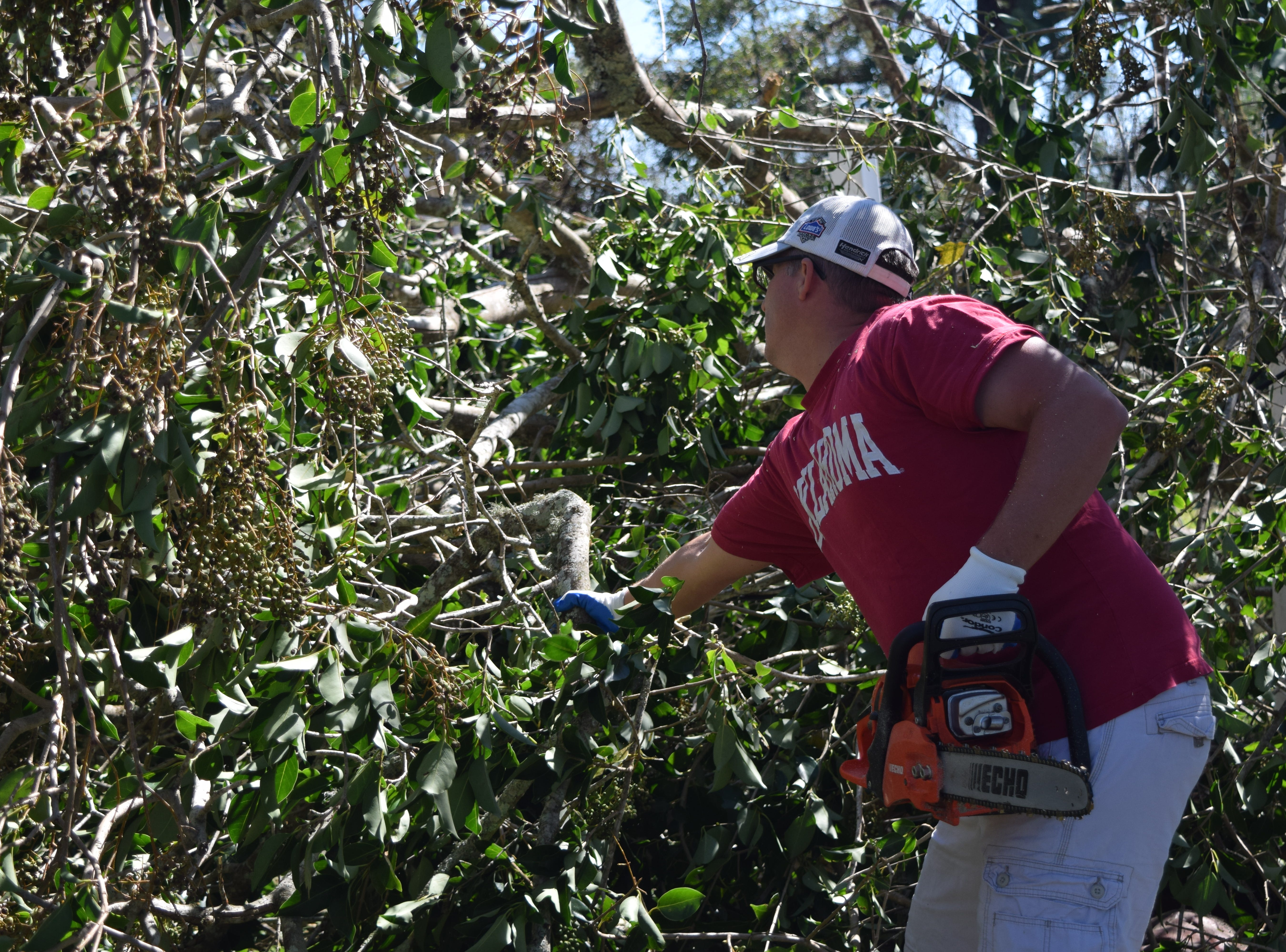 Trey Homan, a volunteer with Mormon Helping Hands, cleans up a house in Quincy after Hurricane Michael.