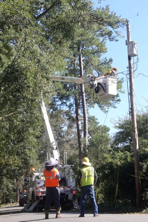Efforts by linemen continue in Tallahassee after thousands are left without it due to Hurricane Michael on Saturday, Oct. 13, 2018.