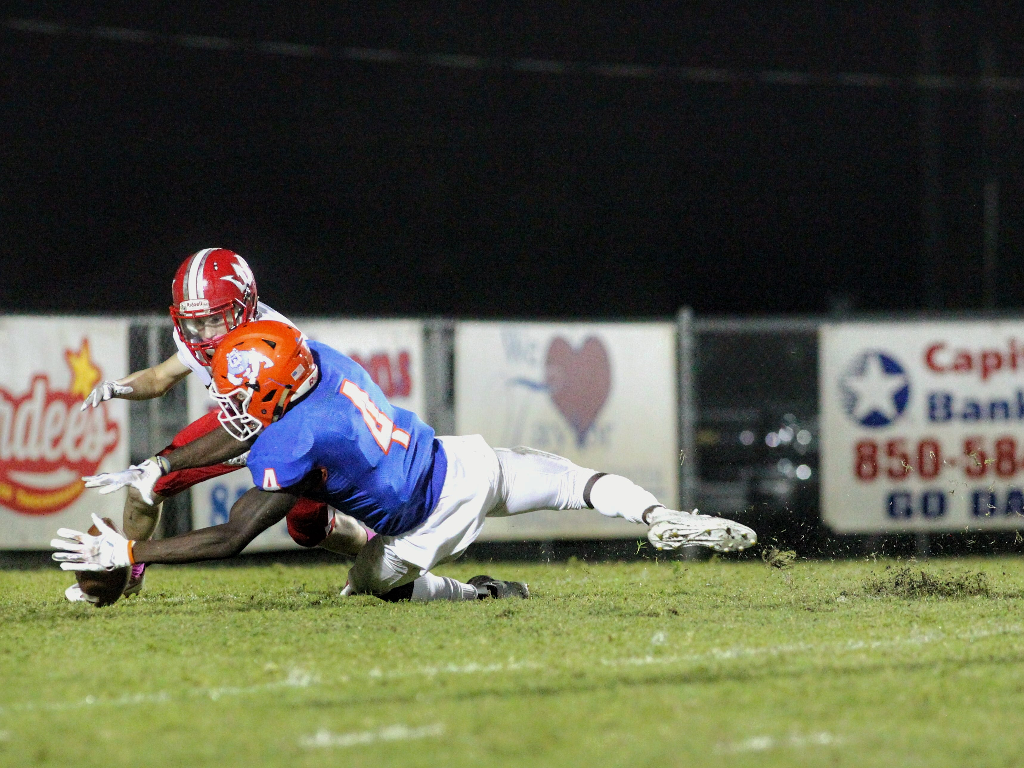 Taylor County's Devante Glover dives on a fumbled punt snap in the end zone for a touchdown during thbe Bulldogs' 35-6 win over Williston.