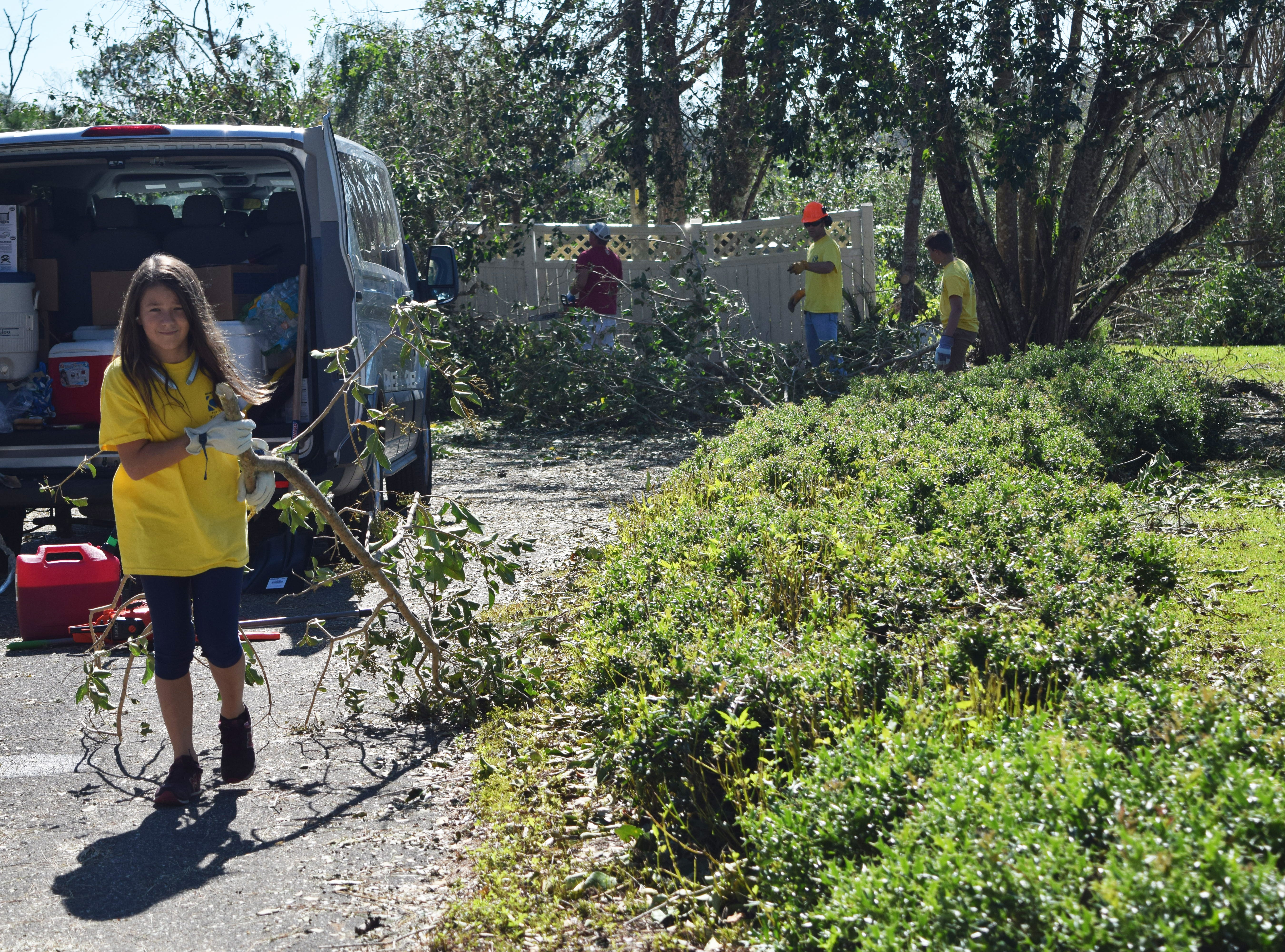 Lucy David, a volunteer with Mormon Helping Hands, cleans up a house in Quincy after Hurricane Michael.