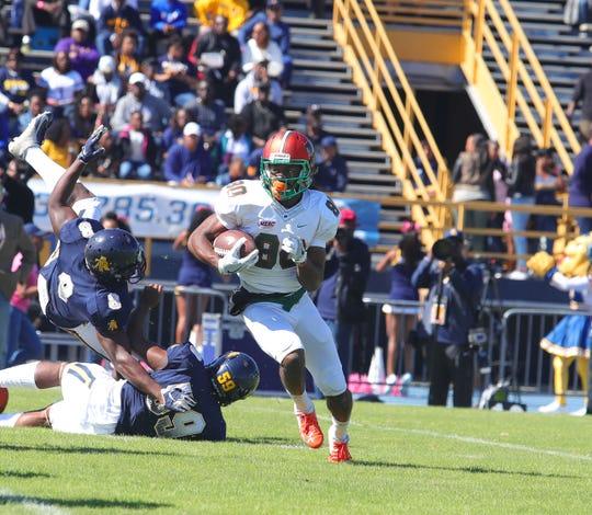 FAMU wide receiver Marcus Williams runs past the Aggies.