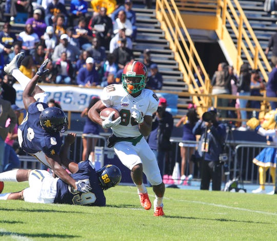FAMU wide receiver Marcus Williams runs past the Aggies.