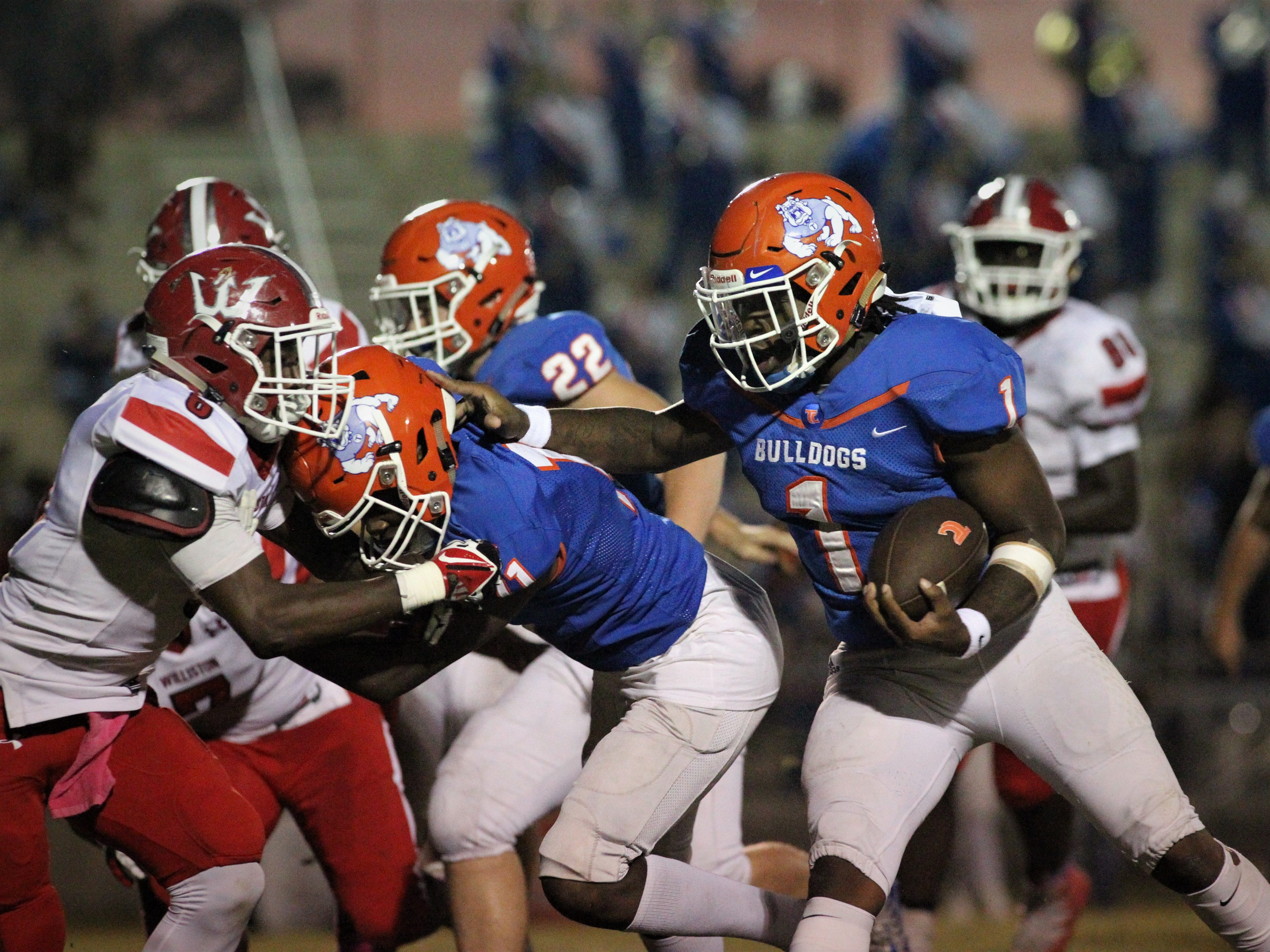 Taylor County quarterback Da'corian Bellamy runs for a big gain as the Taylor County Bulldogs host the Williston Red Devils in a high school football game on Friday, Oct. 12, 2018.