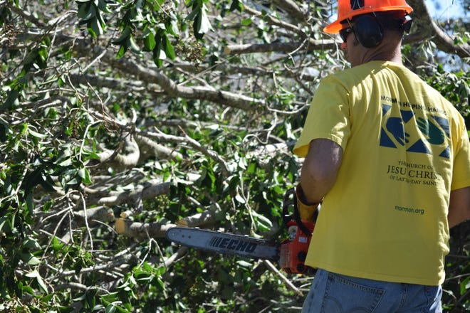 Bradley Coates, a volunteer with Mormon Helping Hands, cleans up a house in Quincy after Hurricane Michael.