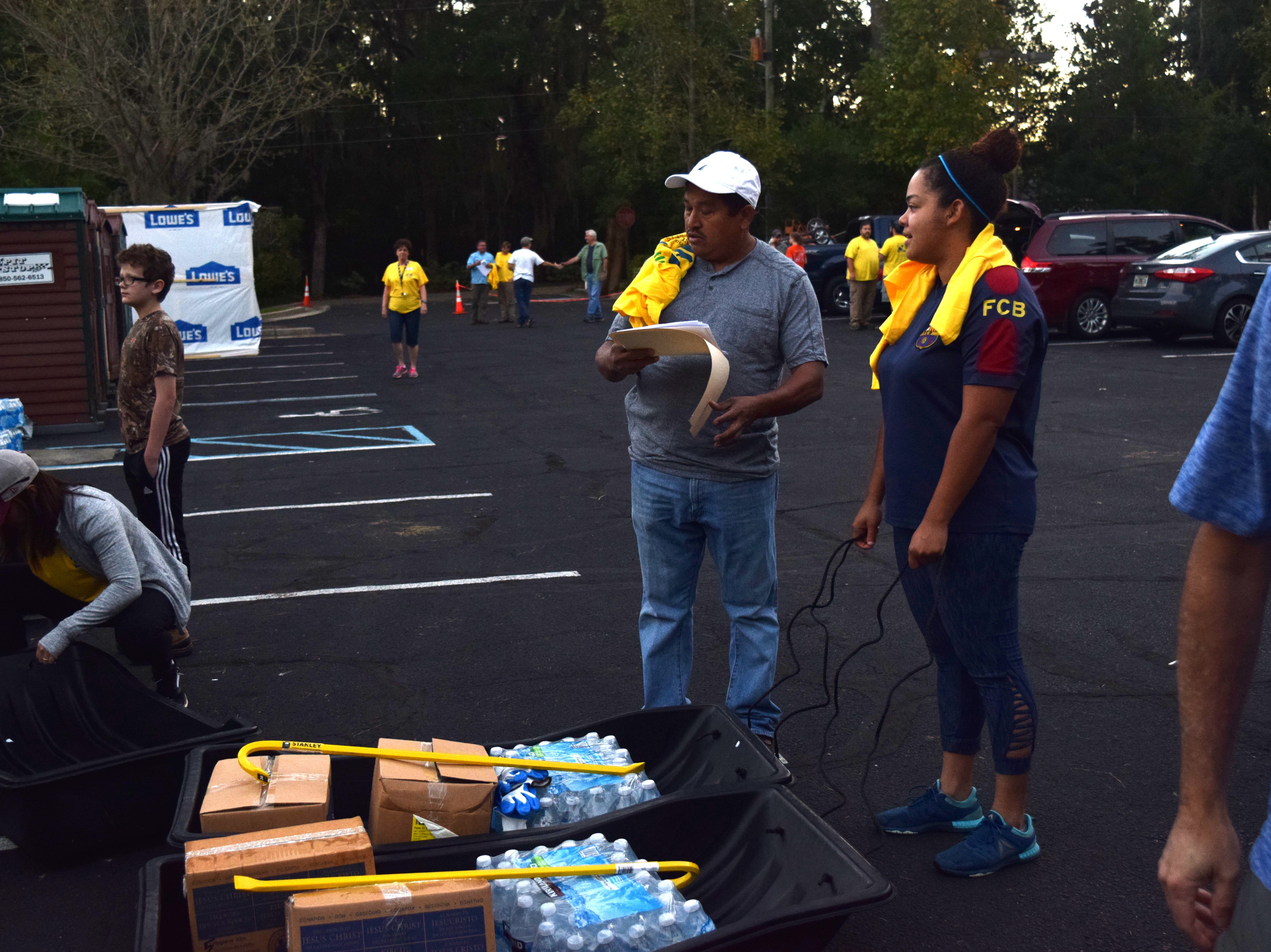 Volunteers collect supplies before heading out to provide recovery aid after Hurricane Michael.
