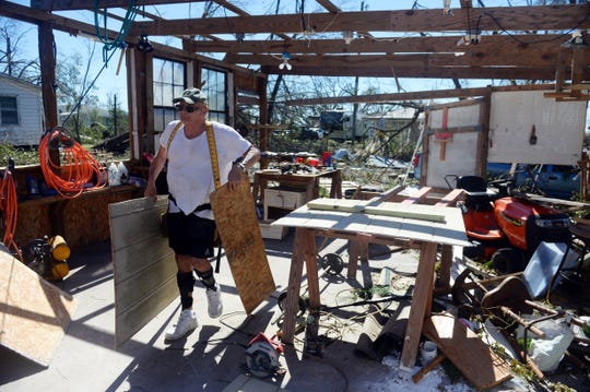 Oct. 12, 2018, Panama City, FL, USA; Clayton Wentworth works in what's left of his shop behind his Panama City home on Friday, Oct. 12, 2018. Hurricane Michael tore most of the shop apart and knocked a large tree onto the roof of his home as he and his wife, Lucretia, rode the storm out.