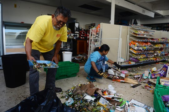 Oct. 12, 2018, Panama City, FL, USA; Ansaruddin Ahmad (left) and Farzana Akter work to clean spoiled food and water from the floor of the Shop N Go Jr. convenience store two days after Hurricane Michael blew through Panama City.