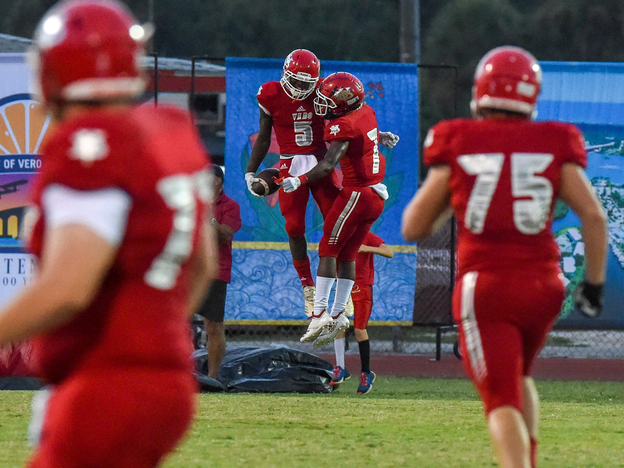 Vero Beach's Jermaine Dawson (5) and Keith Woulard (7) celebrate in the end zone Friday, Oct. 12, 2018, after Dawson scored his team's first touchdown during their high school football game against Treasure Coast at Vero Beach High School. Vero Beach defeated Treasure Coast 34-31.