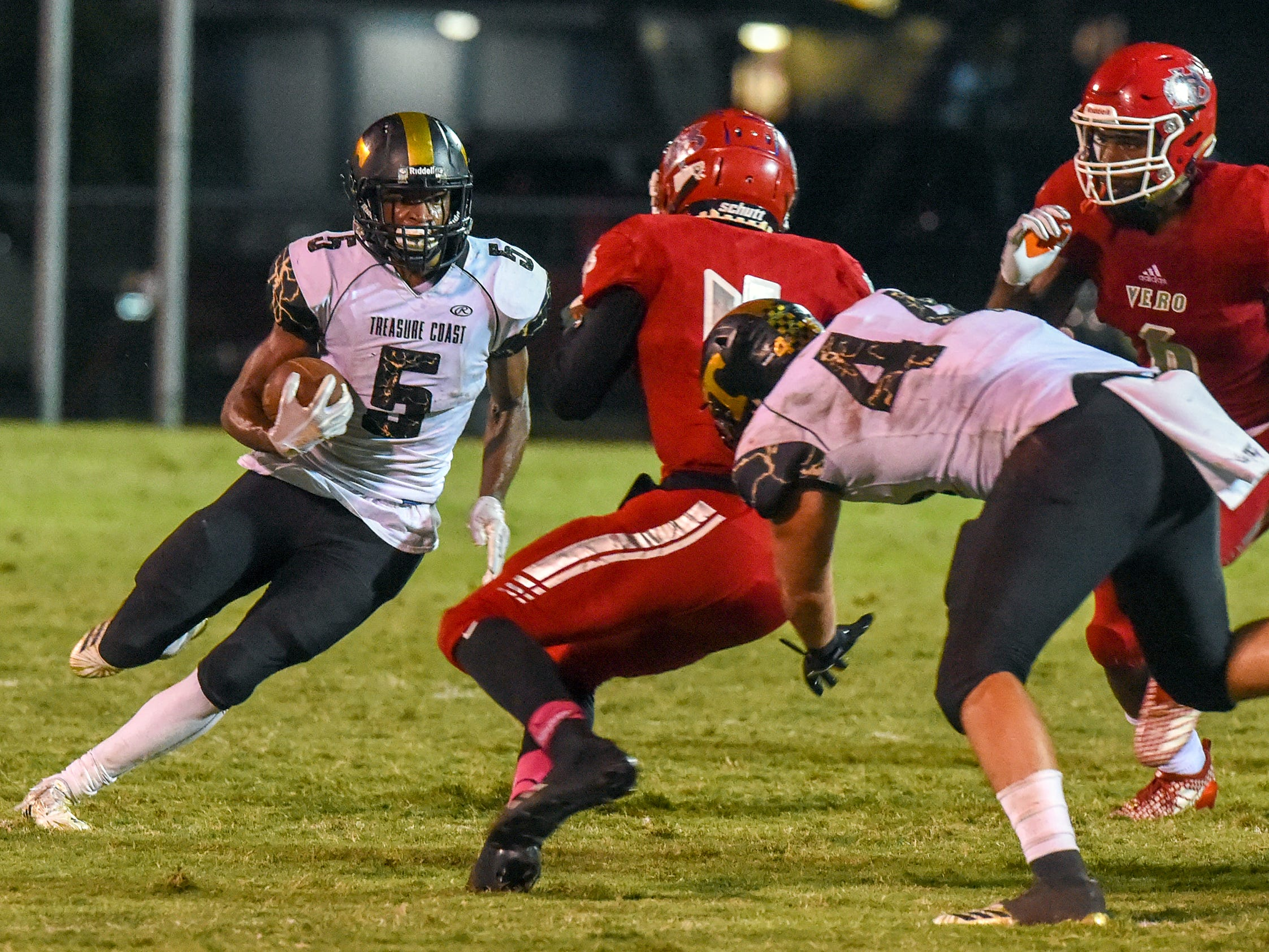 Treasure Coast's Shamar Minnis gets down field Friday, Oct. 12, 2018, during his team's high school football game against Vero Beach at Vero Beach High School. Vero Beach defeated Treasure Coast 34-31.