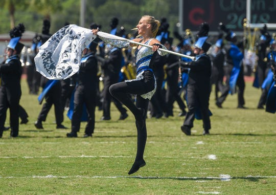 Sebastian River High School Marching Sharks band member Angela Inman performs Saturday, Oct. 13, 2018, during the 37th annual Crown Jewel Marching Band Festival in the Citrus Bowl at Vero Beach High School. Founded in 1981 by James Sammons and Gordon Popple, the Crown Jewel Festival is one of the oldest continuous marching festivals in Florida and features approximately 25 bands competing in 5 classifications every year.