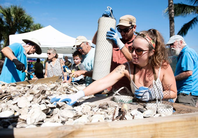 """I grew up here and have seen the river change. It used to be crystal clear. This is the most active thing I can think of doing to to help make a difference,"" said Sara Warren, right, of Stuart who bags oyster shells with her boyfriend, Justin Murray, back, Saturday, October 13, 2018, during the Florida Oceanographic Society's Rally for the River in Flagler Park in downtown Stuart. Visitors got the chance to tour downtown Stuart's living oyster reef, participate in water quality demonstrations, prepare mangrove propagules for planting, and meet local water experts to learn about water-related problems, including toxic algae and red tide."