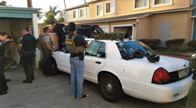 Officers deal with someone they described as uncooperative and barricaded Friday evening in the 1000 block of North A Street in Oxnard.