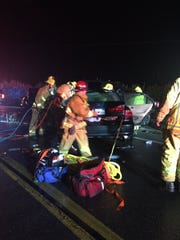 Ventura County firefighters work to assist injured passengers in a crash on Highway 23 north of Moorpark Friday night.