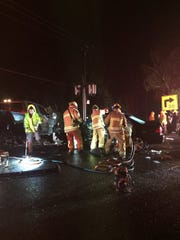 Ventura County firefighters work to assist injured passengers in a crash on Highway 23 north of Moorpark late Friday.