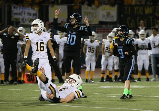 Holder Owen Medina celebrates as kicker Taylin Butterbaugh makes a field goal for Buena in its 20-17 loss to Ventura on Friday night.