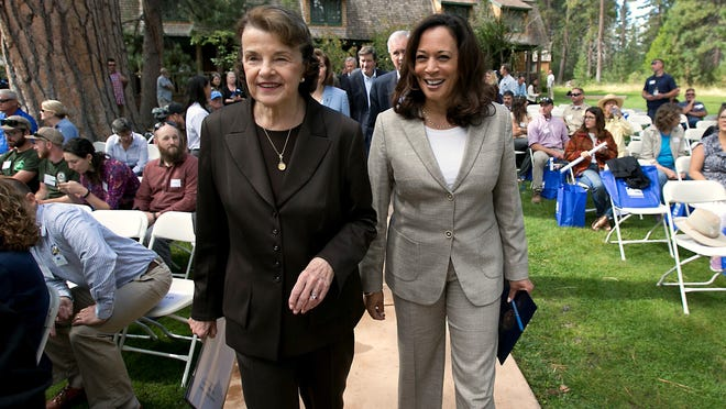 In this Aug. 22, 2017, file photo, California's Democratic United States senators, Dianne Feinstein, left, and Kamala Harris, walk together to speak at the 21st Annual Lake Tahoe Summit in South Lake Tahoe.