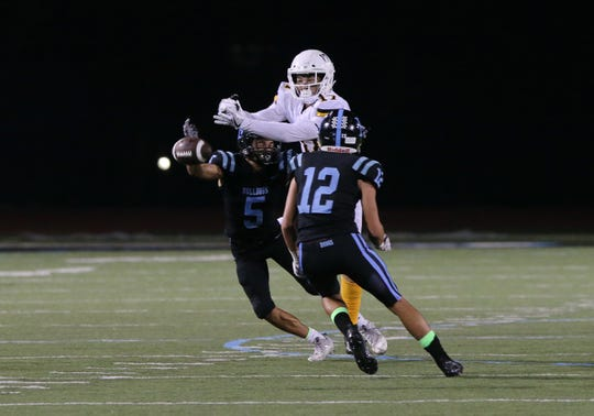 Buena High's Devin Morris and Zach Babcock break up the pass intended for Ventura's Jadon Cline during the second quarter of Friday night's game.