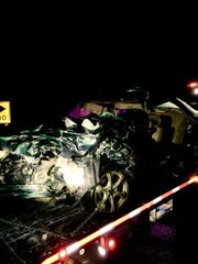 A damaged vehicle being towed from a crash along Highway 23 north of Moorpark Friday.