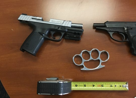 Guns and metal knuckles were seized in a Fillmore burglary case.