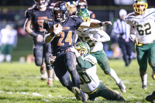 Stratford's Kade Ehrike tries to break free from Edgar's RJ Knetter during the first half of the Tigers matchup with Edgar on Friday in a showdown for the Marawood Conference title. Ehrike rushed for more than 200 yards in the game.