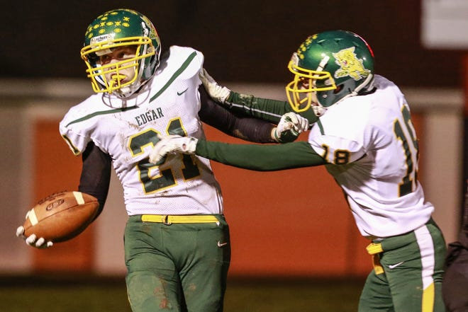 Edgar's Kaleb Hafferman, left, celebrates a touchdown with teammate Drew Guden during the first half of the Wildcats win over Stratford Friday in a battle for the Marawood Conference title