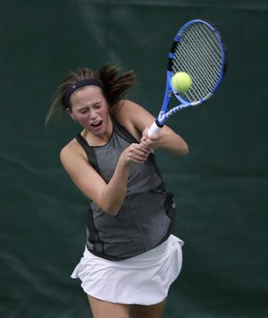 Newman Catholic's Mia Larrain returns a shot in a Division 2 singles semifinal at the WIAA state individual tennis tournament Saturday. The sophomore went on to win the state championship at the Nielsen Tennis Center in Madison.