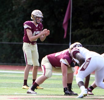 Iona Prep quarterback Derek Robertson gets set to hike the ball on October 13th, 2018 at Iona Prep. Iona Prep would win the game 42-12.