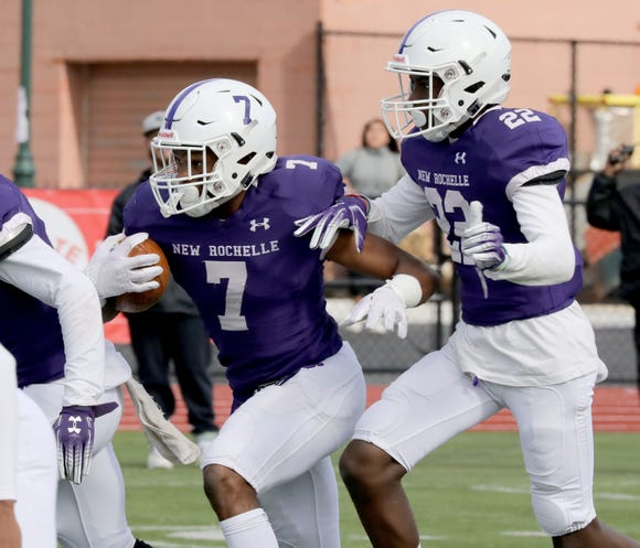New Rochelle's Halim Dixon-King runs with the ball toward the end zone for a touchdown, during their game against Timber Creek at New Rochelle High School, Oct. 13, 2018.