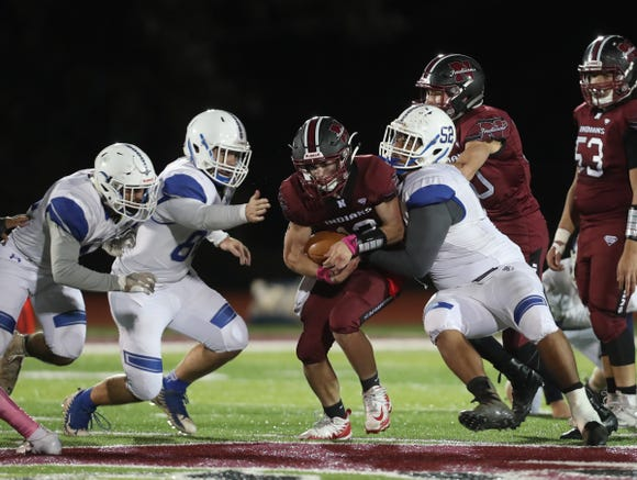 Nyack's Kevin Fowler (12) with the carry during their 25-12 win over Hen Hud at Nyack High School on Friday, October 12, 2018.