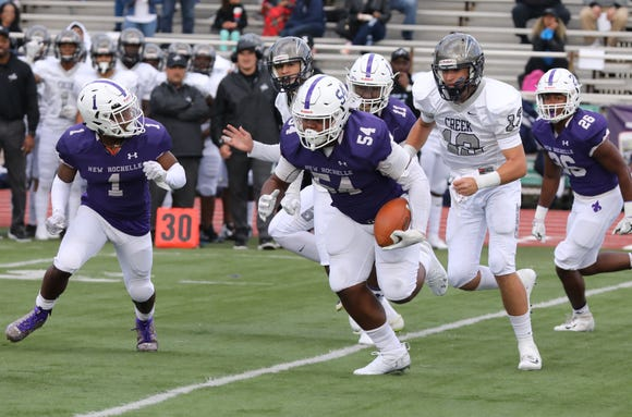 New Rochelle's Jaheim Jones runs with the ball after a blocked kick, to score a touchdown during their game against Timber Creek at New Rochelle High School, Oct. 13, 2018.