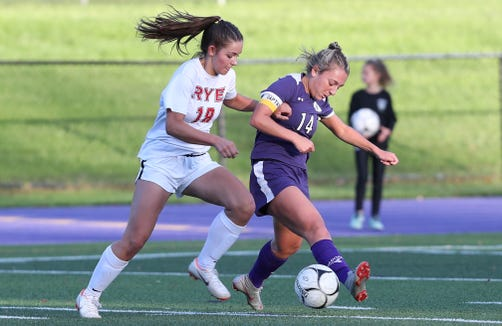 From left, Rye's Leah Kenny (18) and John Jay's Grace Vittoria (14) battle for ball control during a girls soccer game at John Jay High School in Cross River on Oct. 13, 2018.