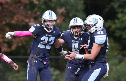 From left, Westlake's Vincent Spaziante (22) Andrew DeBiase (8) and Jacob Petfield (52) celebrates Spaziante's first half touchdown against Pleasantville  during a football game at Westlake High School in Thornwood High School Oct. 13, 2018. Westlake won the game 22-14.