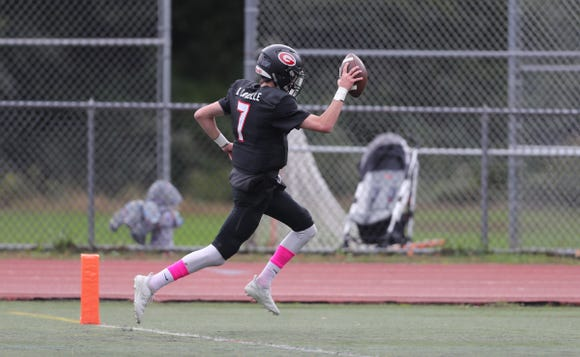 Rye quarterback Declan Lavelle (7) runs in a touchdown during their 34-28 win over Harrison in football action at Rye High School on Saturday, October 13, 2018.