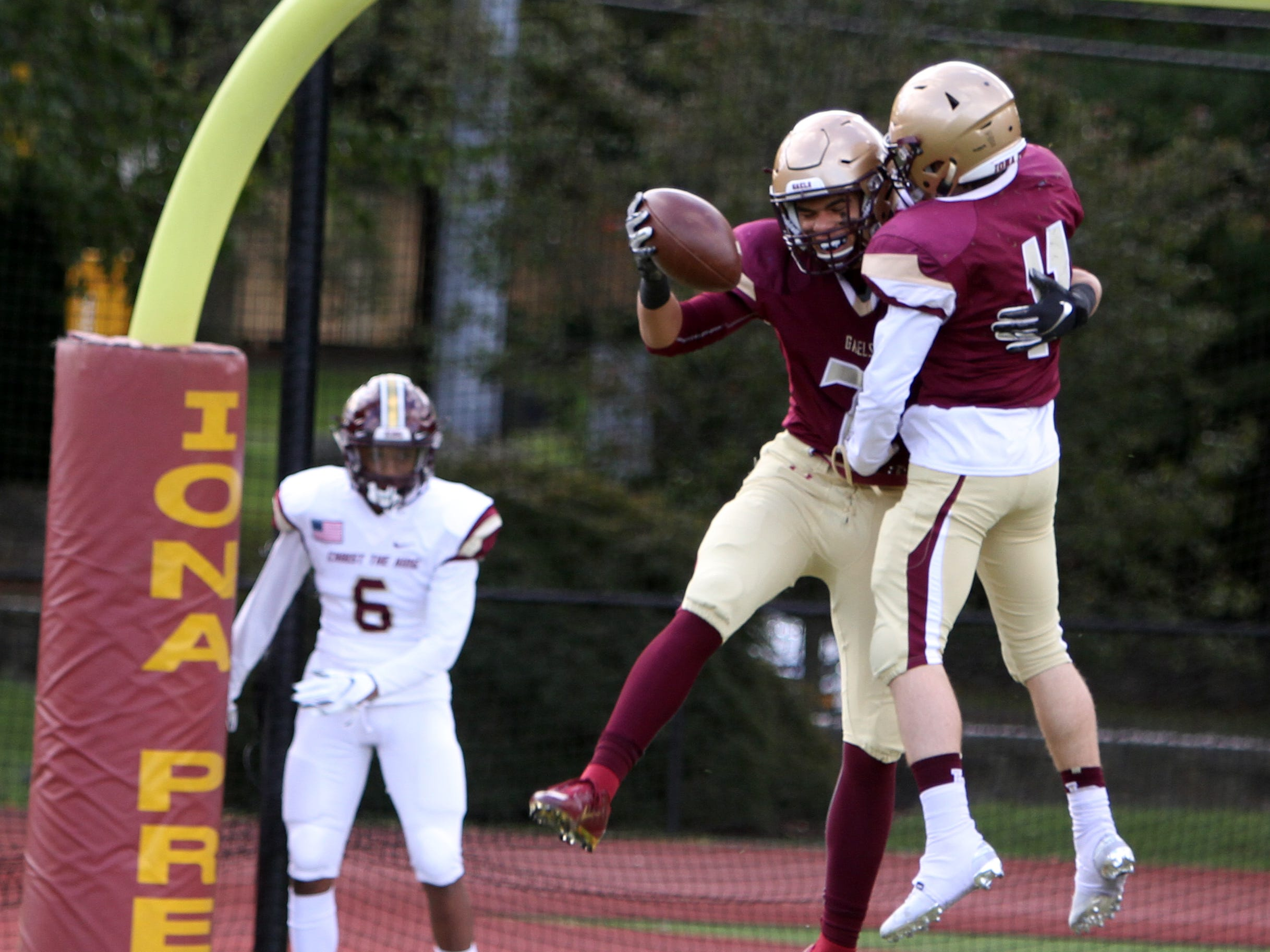 Iona Prep's Alex Williams (left) and Matt Panker celebrate after Williams scored a touchdown during their game against Christ the King on October 13th, 2018 at Iona Prep. Iona Prep would win the game 42-12.
