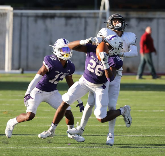 New Rochelle's David Ngatia breaks up a pass intended for Timber Creek's Jayvin Little at New Rochelle High School on Oct. 13.