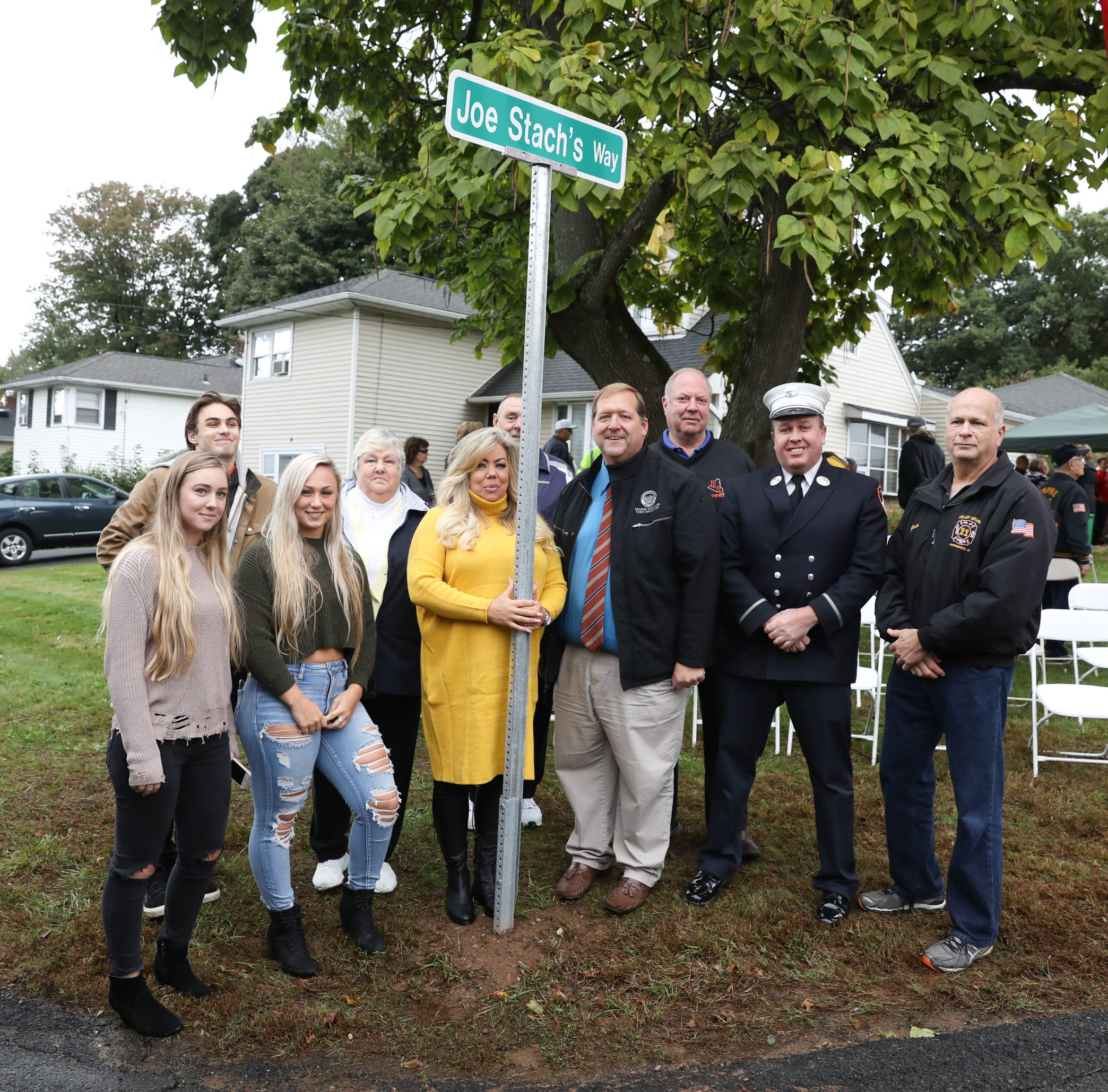 The Stach family unveil the street sign during a street naming dedication for Valley Cottage resident FDNY Lt. Joe Stach on Saturday, October 13, 2018.