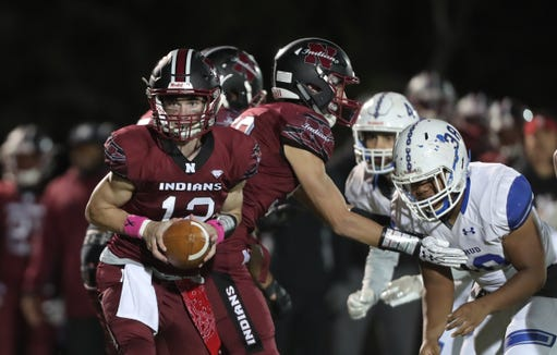 Nyack quarterback Kevin Fowler takes a snap during their 25-12 win over Hen Hud at Nyack High School on Friday, October 12, 2018.