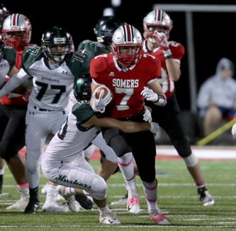 Charlie Balancia of Somers rushes against Yorktown during a Class A playoff qualifying round game at Somers High School Oct. 12, 2018. Somers defeated Yorktown 26-7.