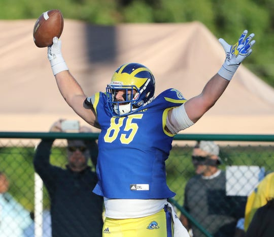 Delaware tight end Charles Scarff celebrates his second touchdown reception of the game in the third quarter of the Blue Hens' 28-16 win against Elon at Delaware Stadium Saturday.