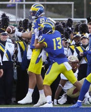 Delaware tight end Charles Scarff (85) comes up with a catch for a touchdown and Delaware's first points of the game in the second quarter as receiver Vinny Papale joins him in celebration against Elon at Delaware Stadium Saturday.