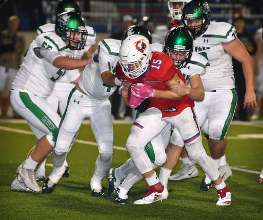 Graham runnigback Daniel Gilbertson (15) is tackled by a host of Iowa Park Hawks Friday night at Newton Field in Graham.
