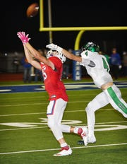 Graham Steer Daniel Gilbertson (15) caught this pass behind the coverage of Cirby Coheley (4) of Iowa Park Friday night at Newton Field in Graham. Graham defeated Iowa Park, 42-14.